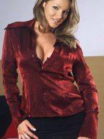 Darby standing in short black skirt and red velvet top.