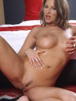 Darby laying back on bed fully nude with legs spread.
