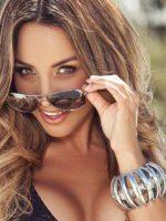 Natalie Pulling Sunglasses Down.