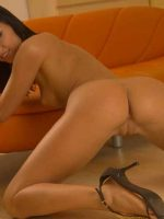Sara kneeing on floor with arms on couch, completely nude with bare butt sticking out.