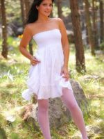 Violet Standing in Forest in White Dress and Pink Stockings